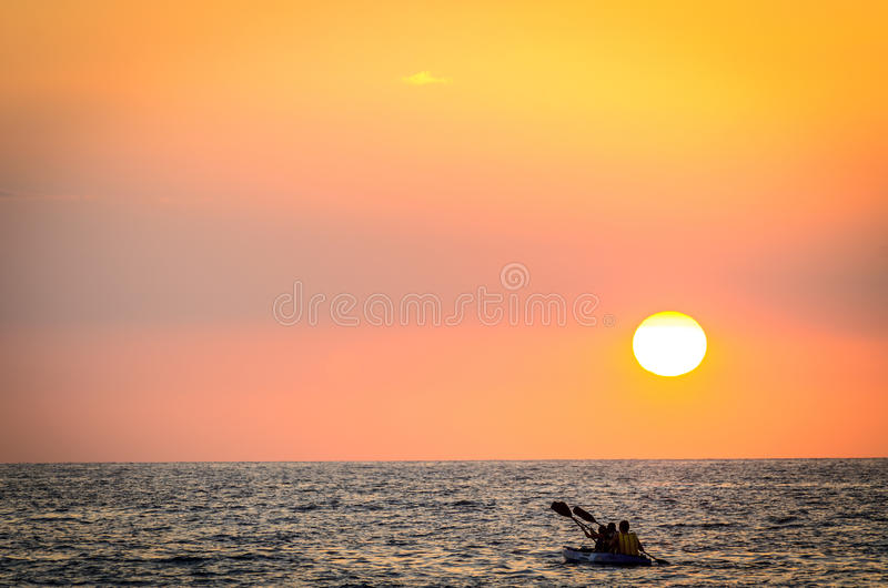 Paddle into the Sunset stock photography