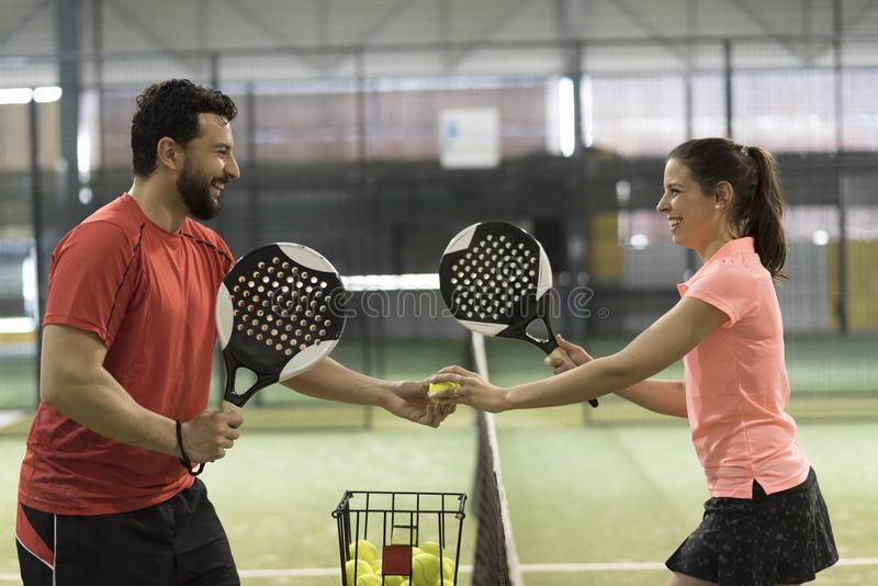 Paddle tennis couple players ready for class royalty free stock images