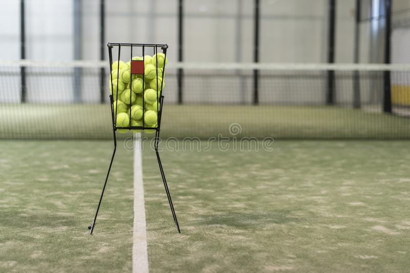 Paddle tennis detail of ball into basket royalty free stock photography