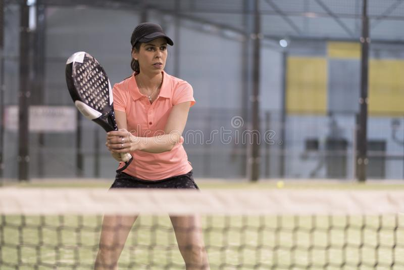 Paddle tennis player ready to play royalty free stock photography