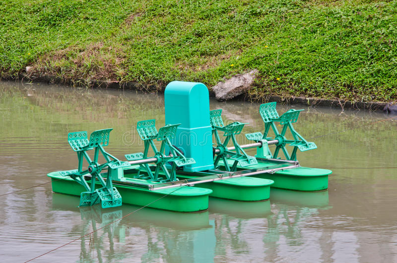 Paddle Wheel Aerator. In pond stock photography