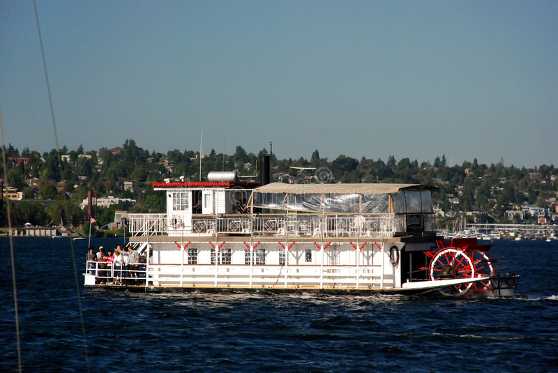 Paddle wheel Boat. Large white paddle boat with red trim on the water royalty free stock photos