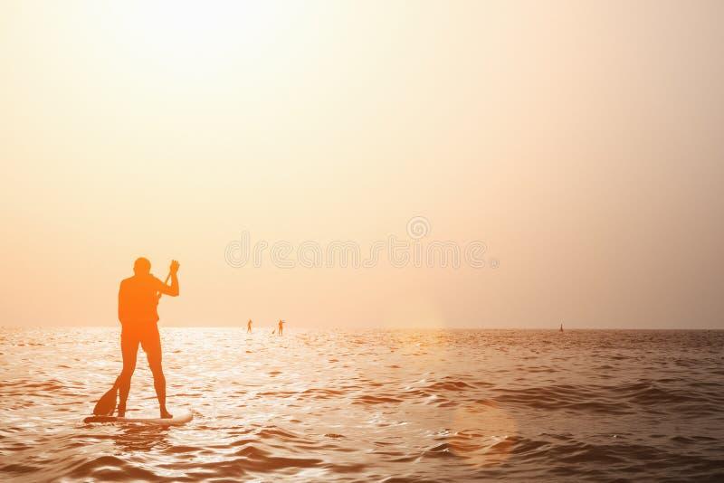 Paddleboarding images stock