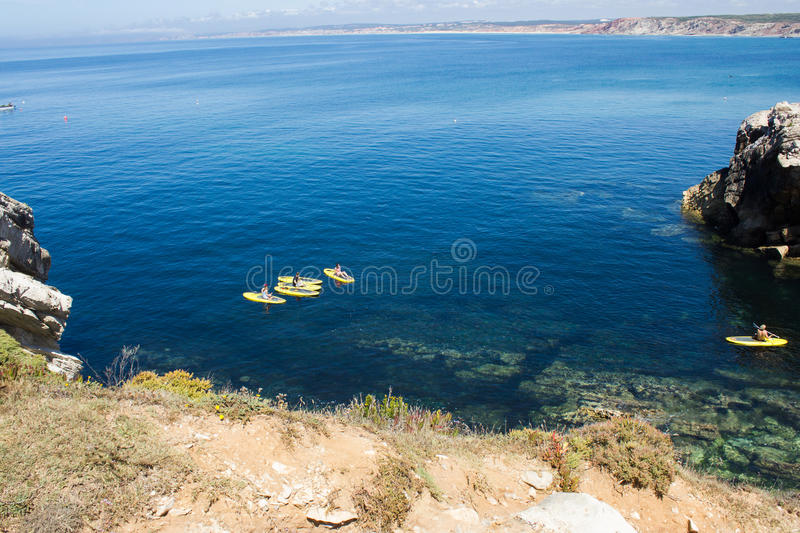 Paddleboarding class in Baleal bay, Peniche, Portugal. Water sports. Water sports in Atlantic Ocean, Baleal bay, Peniche municipality, Leiria district, Portugal stock photography
