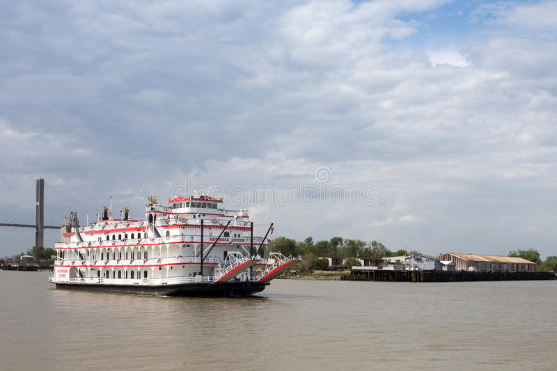Paddlewheel Boat Cruise on Savannah River. Savannah, GA - March 27, 2017: The Georgia Queen is an 1800s style paddlewheel riverboat and tourist attraction in royalty free stock photos