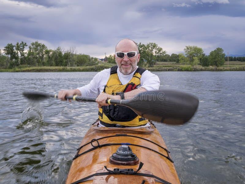 Paddling sea kayak royalty free stock images