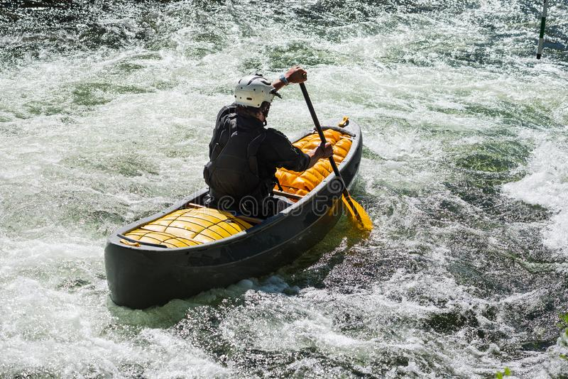 Whitewater canoe in turbulent water royalty free stock photo