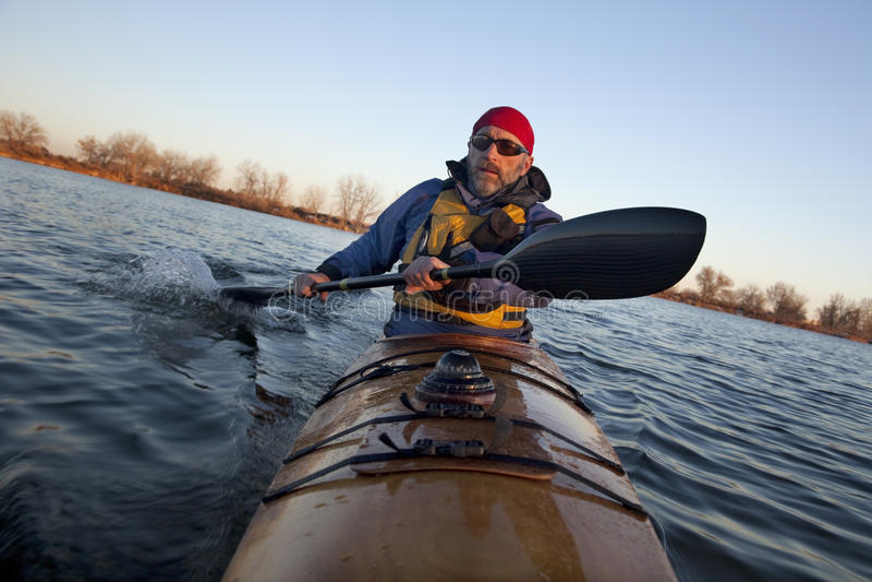 Paddling workout in a sea kayak royalty free stock photos
