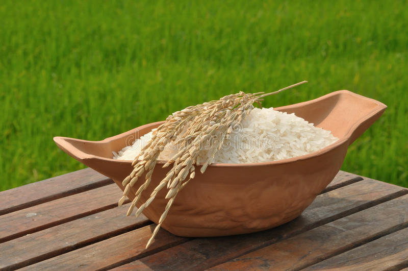 Download Paddy Rice On Wood Table In Rice Field Background Stock Photos - Image: 29030923