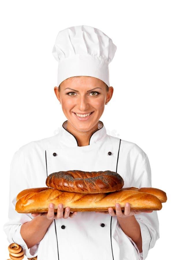 Padeiro fêmea bonito ou cozinheiro do cozinheiro chefe que sustentam um naco bonito Brea fotos de stock