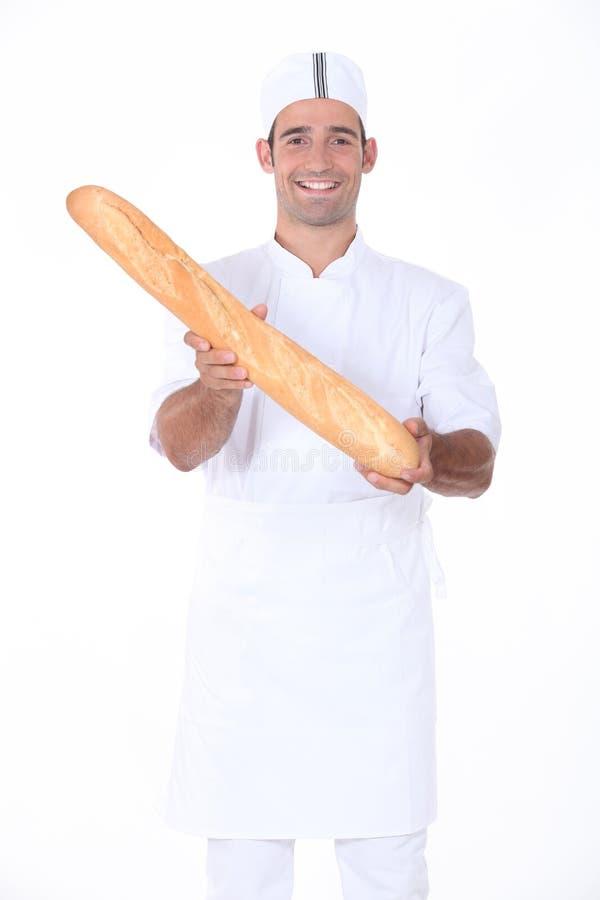 Padeiro que indica o pão imagens de stock royalty free