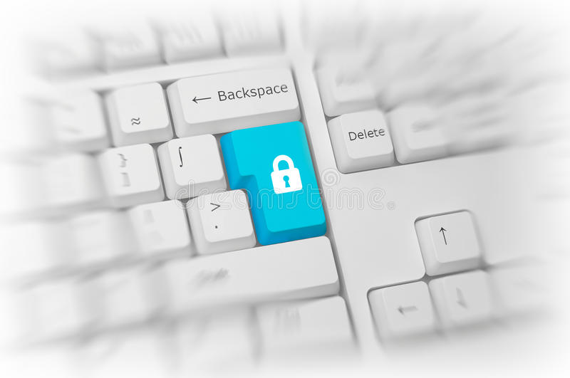 Padlock on a blue computer key. Padlock icon on a colorful turquoise blue computer key on a white keyboard with blur and selective focus conceptual of online royalty free stock photography