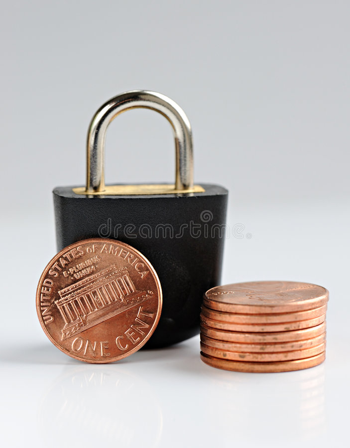 Padlock with cents. On a grey background royalty free stock photo