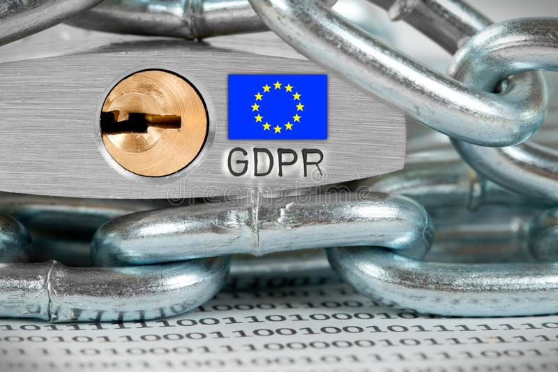 Padlock and Chains Concept. Macro photo of padlock and data on the paper with EU flag and GDPR letters imprinted on metal surface stock photo