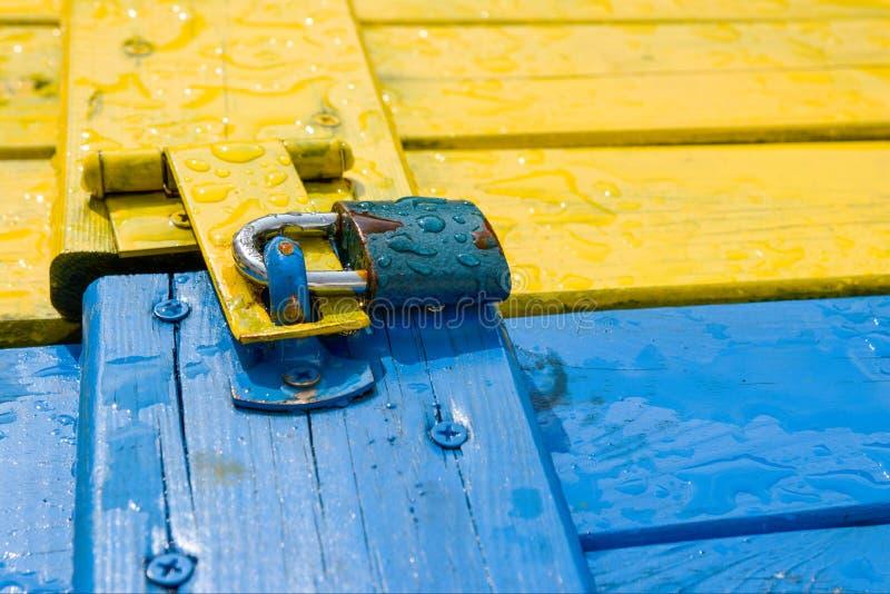 Padlock on colour wooden door stock images