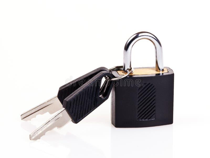 Padlock con claves imagen de archivo