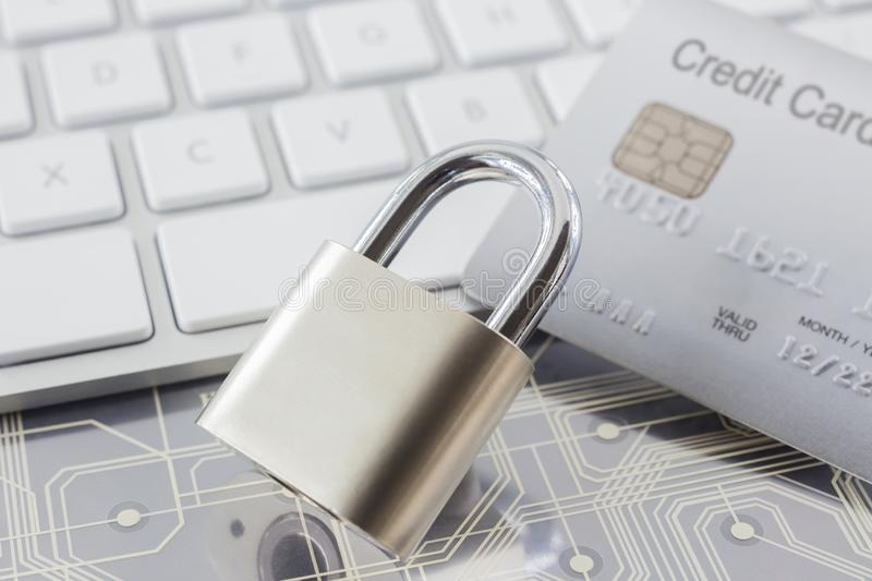 Padlock and credit card on keyboard and electronic circuits royalty free stock photo