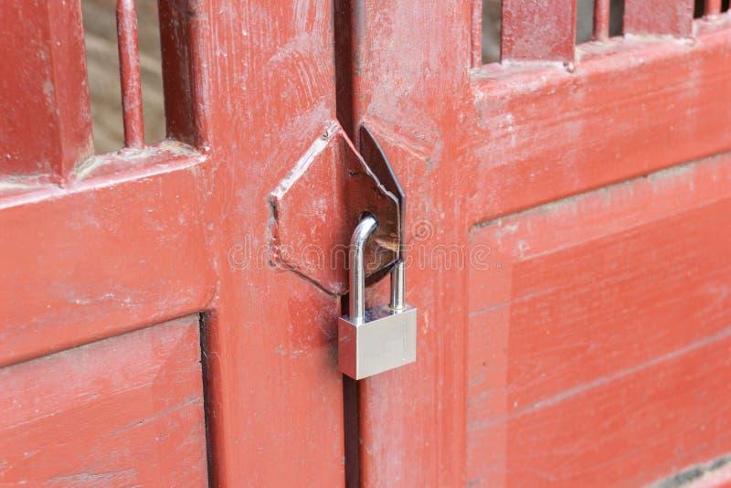 Padlock on the door for wooden door. Close-up padlock on the door for wooden door lock at home royalty free stock photography