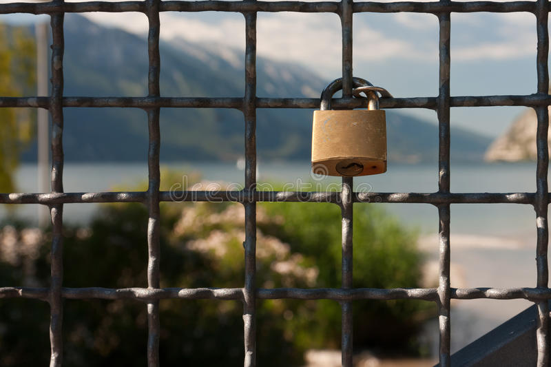 Padlock on the fence royalty free stock photos