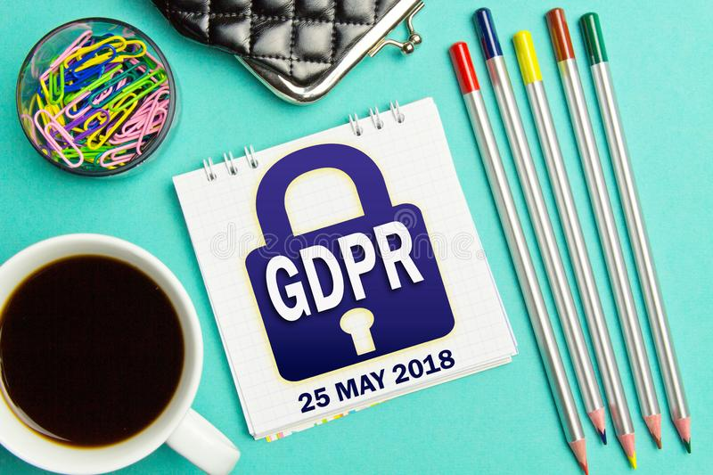 Padlock GDPR notification in the notebook of a businessman on a turquoise background .General Data Protection Regulation concept royalty free stock photography