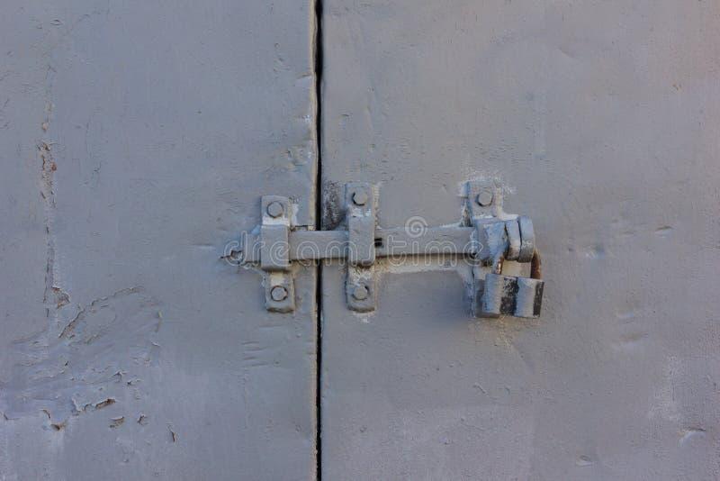 Padlock on the gray iron doors royalty free stock photo