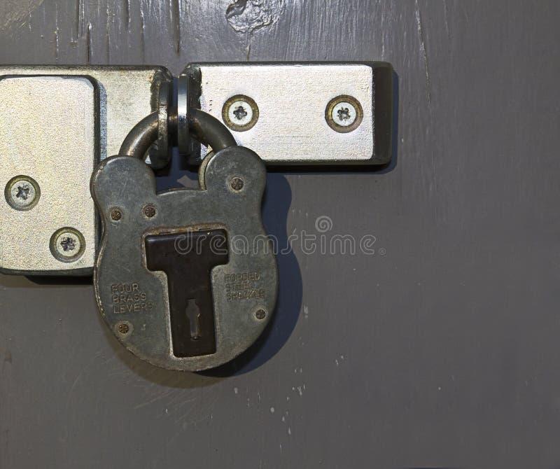 Download Padlock on grey door stock photo. Image of dirty, grey - 23558920