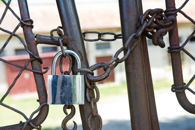Padlock with iron chains and fence royalty free stock images