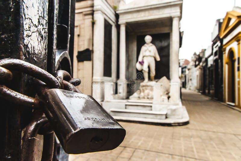 Padlock. A padlock in an iron gate at a cemetery stock photos