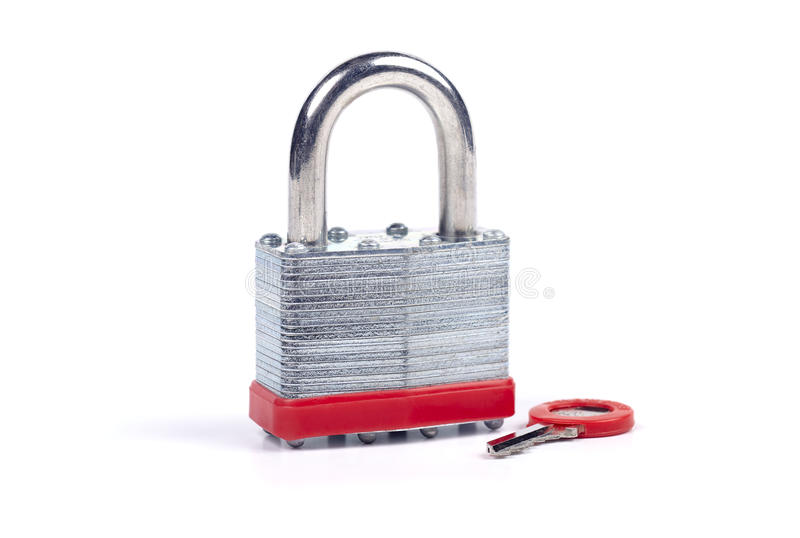 Padlock with key. Steel padlock with key on a white background stock images