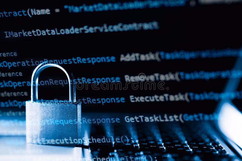Padlock on laptop with a programming language. Internet data privacy information security concept. Antivirus and malware defense.  stock image