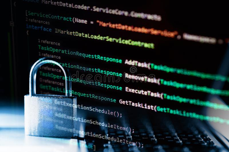 Padlock on laptop with a programming language. Internet data privacy information security concept. Antivirus and malware defense.  stock photos