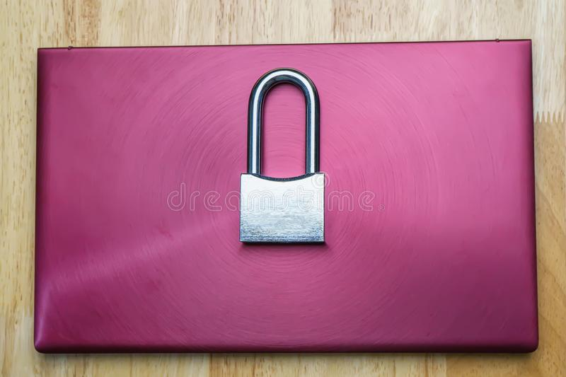 Padlock on laptop. The silver padlock on laptop. The computer is cyber security royalty free stock image