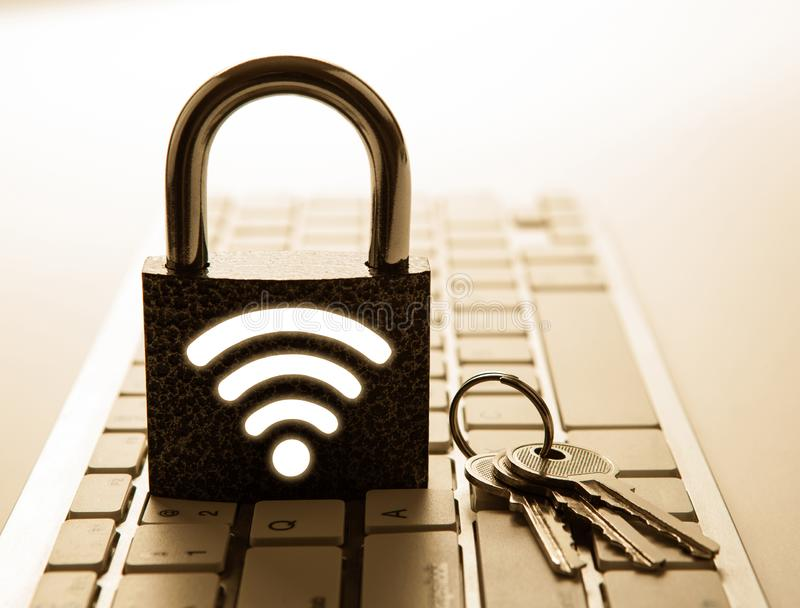 Padlock with password wi-fi with keys on the computer keyboard Internet security stock image