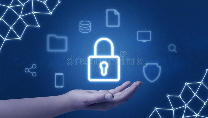 Padlock security in hand surrounded with internet services icons. And network threads stock images