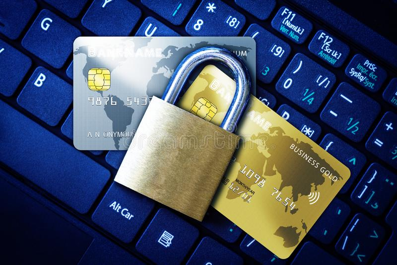 Padlock on Top of Credit Cards on Keyboard Cyber Security Concept. Golden padlock on top of fictitious credit cards on computer keyboard. Concept of Internet royalty free stock photography