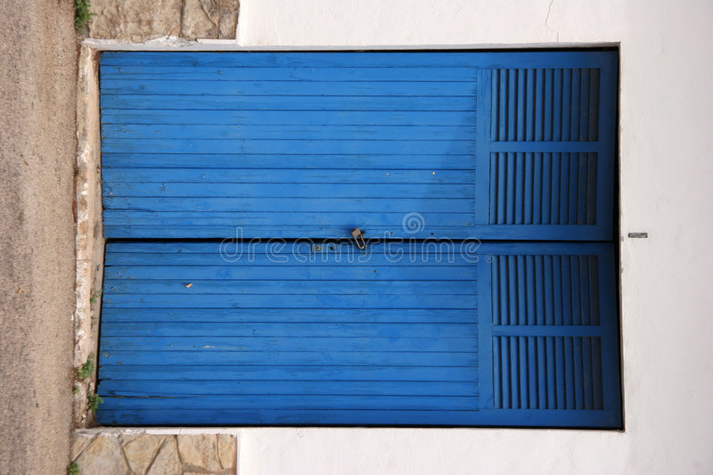 Padlocked industrial doors royalty free stock images