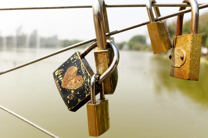 Padlock with love writings on bridge vector illustration