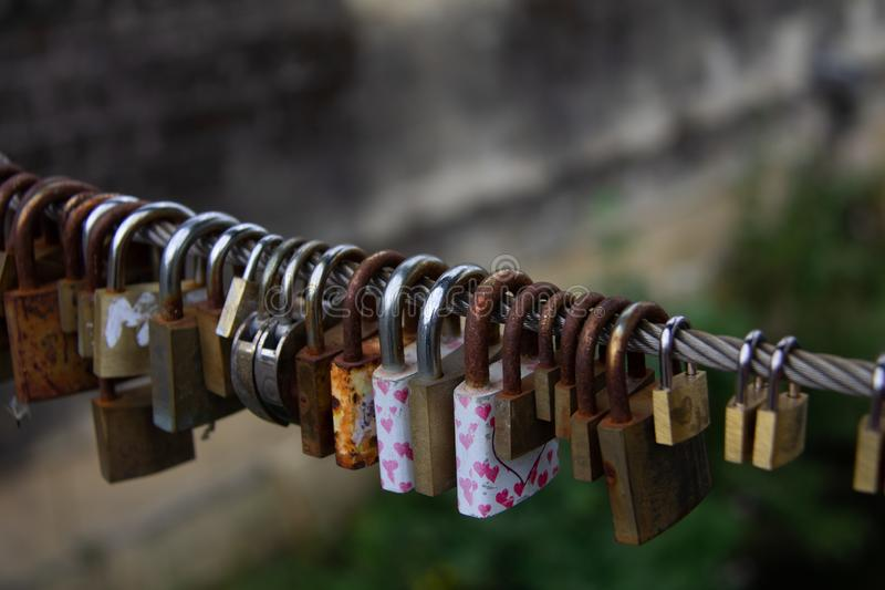 Padlocks, love lock on a bridge sign of connection. Padlocks, love lock on a bridge as a sign of connection. Cables and fences on bridges used for locks padlocks royalty free stock photography