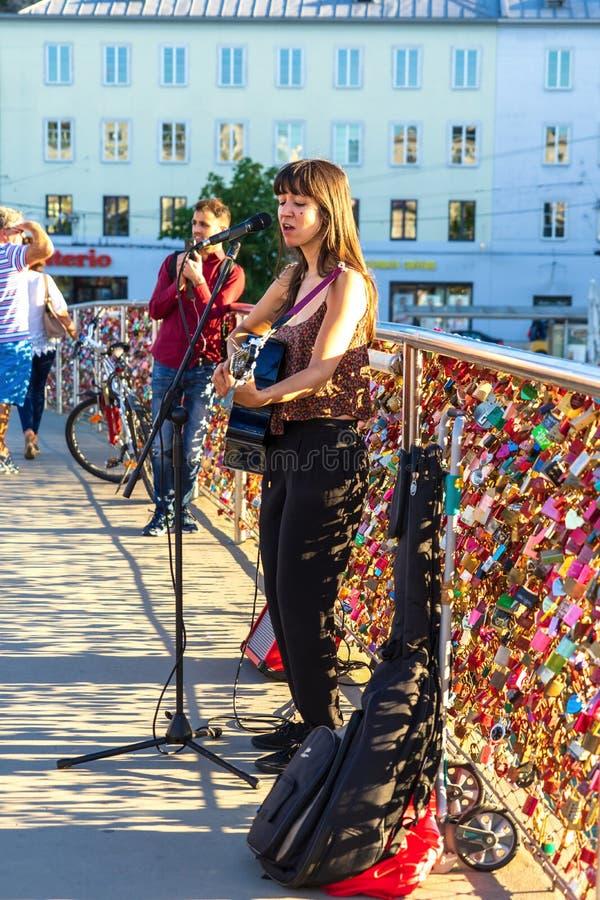 Singing at Salzburg on lovers bridge royalty free stock photo