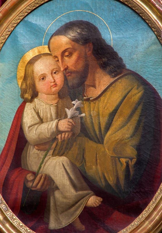 Padoue - St Joseph avec la peinture d'enfant de l'autel latéral dans l'église Basilica del Carmine image libre de droits