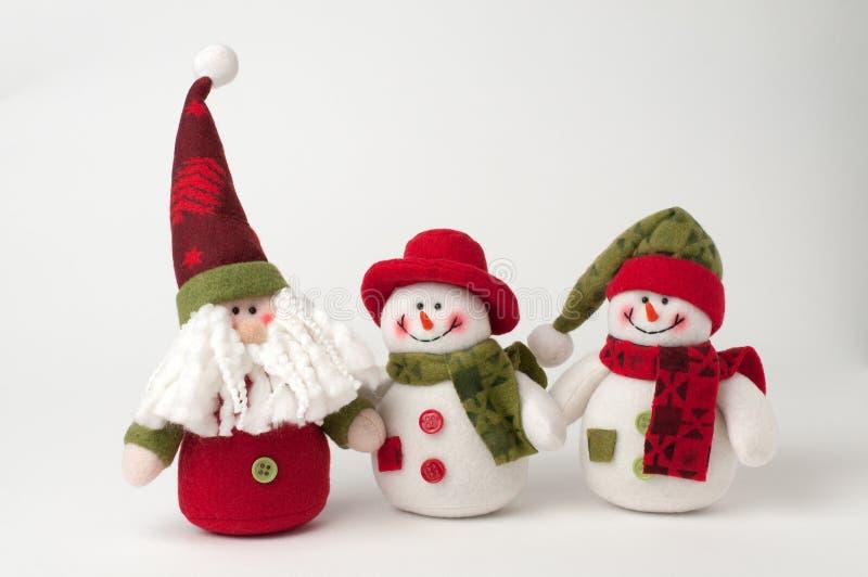 Padre Christmas y muñecos de nieve fotografía de archivo