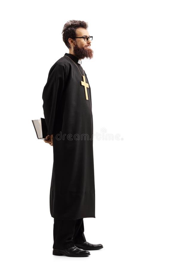 Padre com uma Bíblia que espera na linha imagem de stock