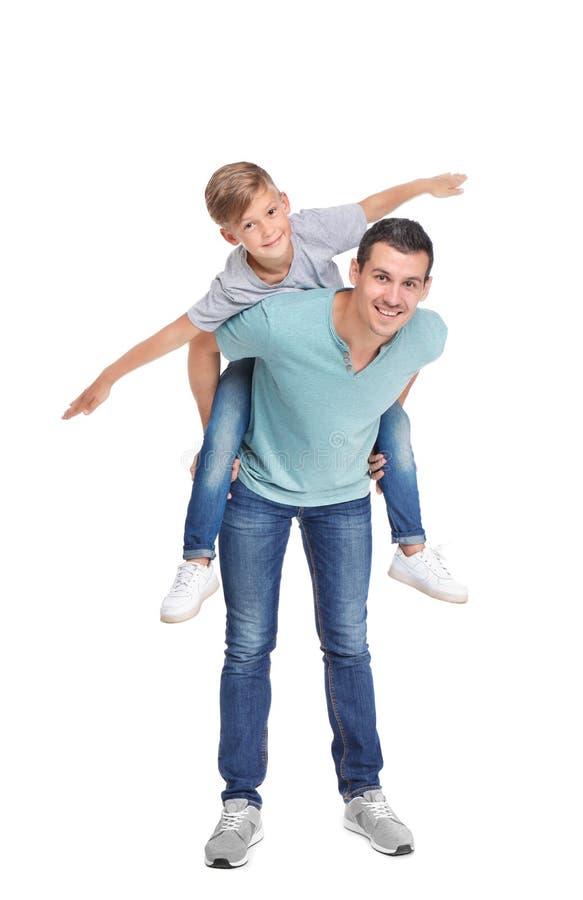 Padre con el niño en el fondo blanco foto de archivo libre de regalías