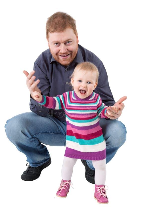 Padre dai capelli rossi e sua piccola la figlia isolati   immagini stock