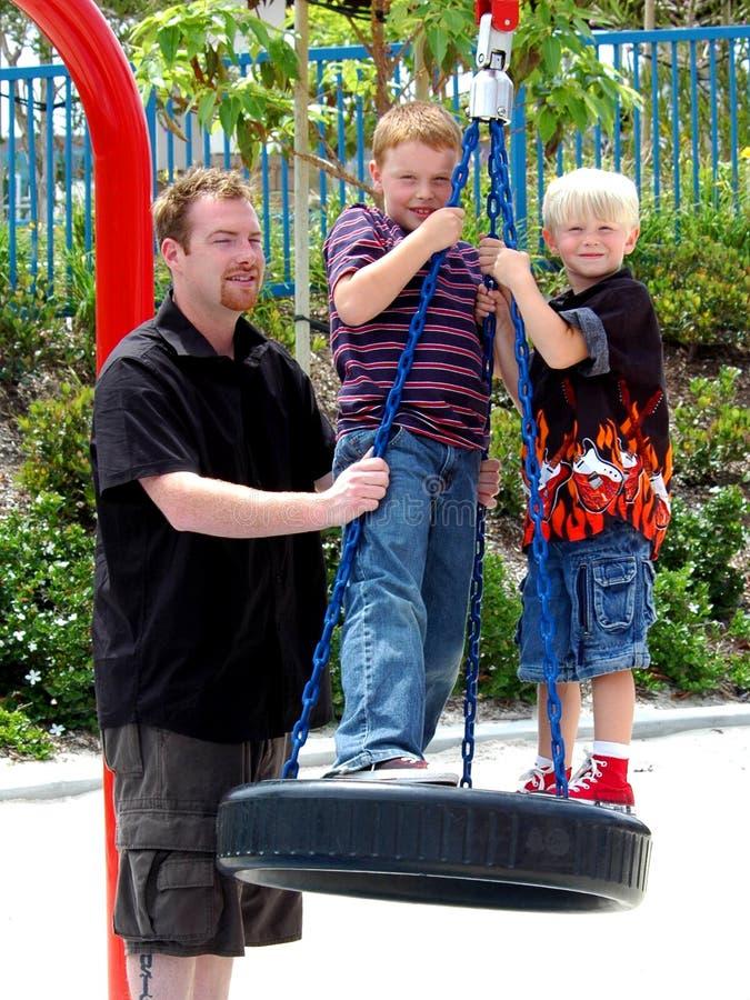 Padre e figli fotografia stock