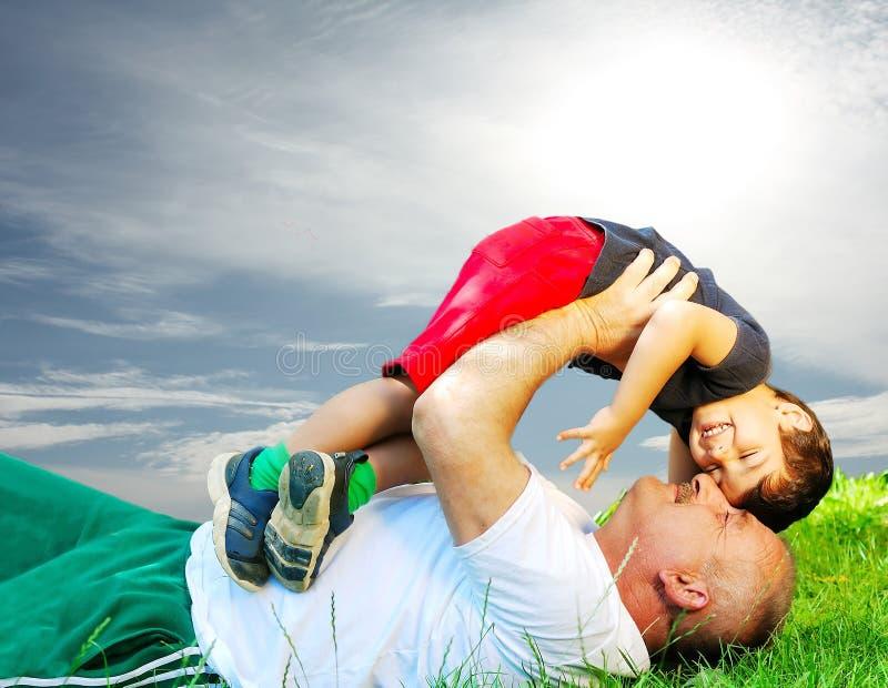 Padre e figlio felici immagini stock libere da diritti