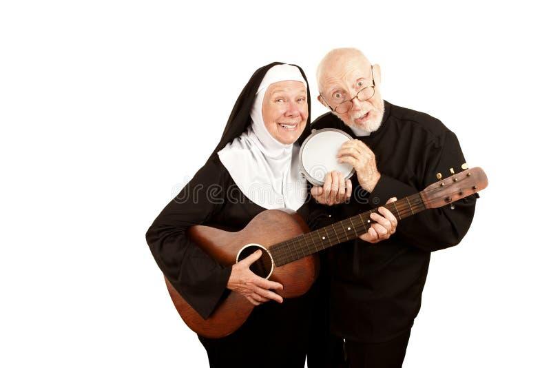 Padre e freira musicais fotografia de stock royalty free