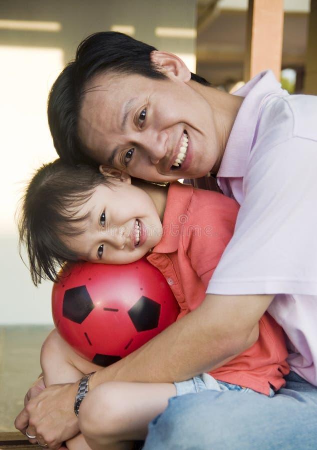 Padre e hija asiáticos imagenes de archivo