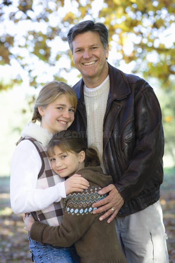 Padre e hijas imagen de archivo libre de regalías
