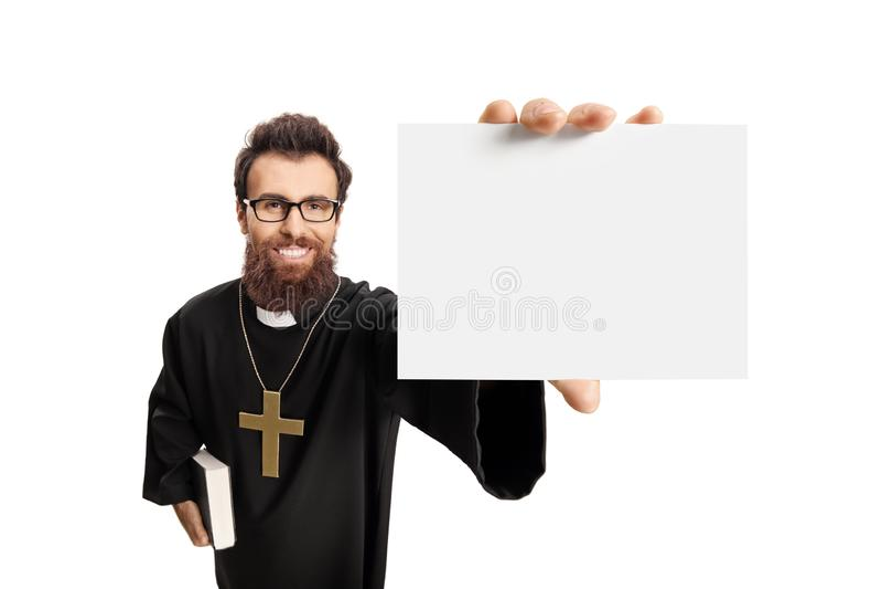 Padre novo que guarda um cartão vazio imagem de stock